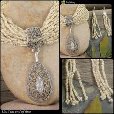 """REDUCED!! Ivory Bead/Silver Teardrop Necklace Set. Dazzling clear crystals accent the 2"""" marcasite-look filigree silvertone teardrop pendant that dangles from this designer-style 27"""" adjustable necklace made of hundreds of shimmering cream seed beads with matching pierced wire earrings. Jewelry Necklaces"""