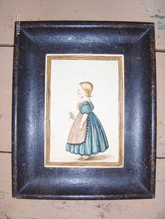 """1830 style watercolor of a little girl in a blue dress by Steve Shelton.  5"""" X 7"""" in a grungy painted frame."""