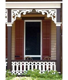 A front porch with railings and brackets painted white to make them pop from the dark columns. ThisOldHouse.com #frontporch