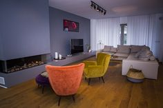 Interior design project in Bucharest. Modern renovation with velvet armchair and leather  sofa. Grey walls and beautiful light.