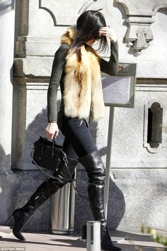 She's in fashion: The 19-year-old supermodel dressed her lean and slender frame in a sexy ...