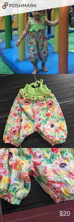 12m green Romper with flowers Bought at Dillard's. super cute romper! 6 snaps in between the legs. Top part is stretchy material. 12 month 22-25lbs cotton. By First Impressions. First Impressions One Pieces