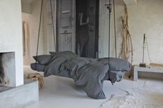 Would love a hanging bed like this on a big ol' southern-style screen porch!