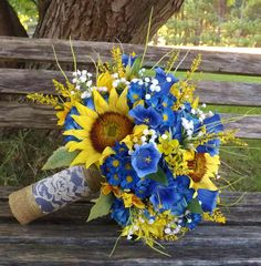 Rustic sunflower and cobalt/royal blue bridal bouquet with burlap and lace.