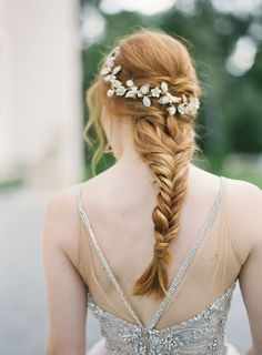 Gorgeous fishtail braid topped by a delicate shimmery white floral hairpiece // Consider us under the spell of Bella Belle's idyllic spring editorial, shot entirely on film at the romantic Chateau Cocomar in Houston, Texas by Kurt Boomer. Known for their comfortable bridal shoes, the shoe brand has teamed up with Joy Proctor of Joy Proctor Design to create three pairs of wedding shoes inspired by three of the most important women in her life
