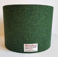 The dark, richness of this plain twill makes this dark green Harris Tweed lamp shade the perfect choice for any interior design. Available in a variety of shapes and sizes.