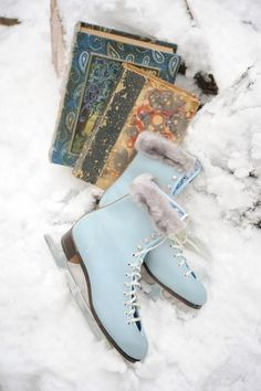 .Love these light blue skates! We had a pair just like these when I was little. Made angora pom poms for them!