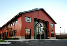 Board and Batten exterior end with standing seam roof, industrial storefront and uncovered wooden structural components create an Annapolis twist on a Pacific Northwest American look. This 2 story workplace constructing is ready as Metal Building Homes, Building Exterior, Building Design, Building A House, Shop Buildings, Steel Buildings, Factory Architecture, Architecture Design, Board And Batten Exterior