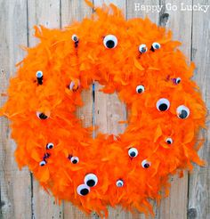 Halloween Monster Wreath using feather boas and google eyes