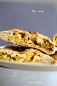 Vegan Naan Calzone stuffed with Spicy Tofu and Peas scramble and vegan cheese. Easy carry out lunch. Vegan Recipe. How to make Naan Calzone