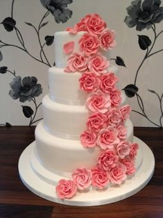 My ever Wedding Cake with four tiers of luscious Lemon cake, ivory icing and cascading coral roses. Wedding Cake Roses, Beautiful Wedding Cakes, Rose Wedding, Beautiful Cakes, Amazing Cakes, Perfect Wedding, Dream Wedding, Spring Wedding, Coral Roses