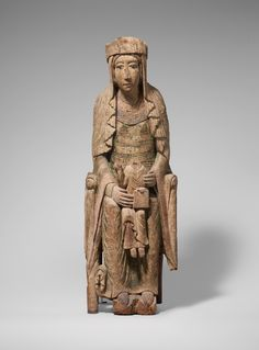 Enthroned Virgin and Child.  Date:     1130–1140. Geography:     Made in Burgundy, France. Culture:     French. Medium:     Birch with paint and glass.