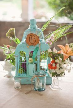 love the style of this wedding! birdcage centerpiece