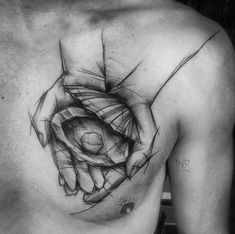 Magnificent black ink homemade like chest tattoo of hands holding shell with pearl