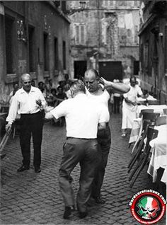 Italian dads dancing in Italy. Love this picture