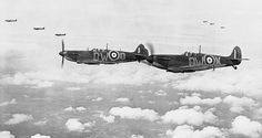 An iconic Battle of Britain photo, Spitfires from, 610 Squadron, based at Biggin Hill, Kent, fly over South East England.