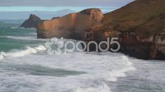 Waves break on Cliff near Dunedin, New Zealand - Stock Footage   by JahnProductions