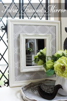 ThriftyFabric Framed Mirror, I like this idea, maybe use a decorative scrapbook paper and modge podge.....mdb