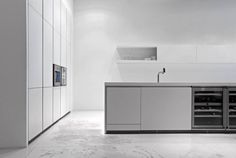 bulthaup b1; the essential kitchen in alpine white, wall units and gagganeau appliances