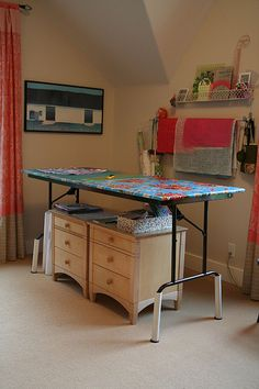 Great idea to raise a cutting table to ease back and neck strain while cutting fabric!