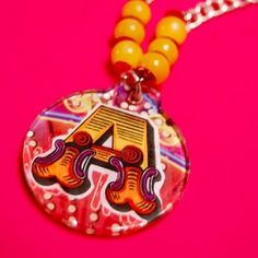 Alexa shows you how to make some pretty and colorful personalized pendant necklaces using magazines!