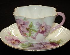love those Shelley teacups,  this is a particularly pretty one with orchids.#Teacup. Works of art that you can use. Love it.