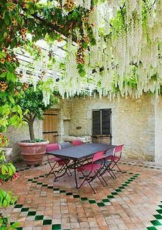 Beautiful patio or courtyard. Look like white wisteria is dripping through the pergola. Outdoor Areas, Outdoor Rooms, Outdoor Living, Outdoor Furniture Sets, Outdoor Decor, Outdoor Seating, Dream Garden, Home And Garden, Provence Garden