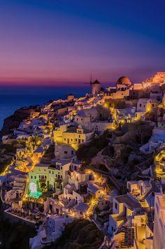 Purple night in Oia Santorini by George Papapostolou
