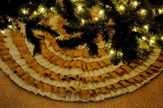 This rustic, ruffled Christmas tree skirt is an inexpensive project made from burlap. | 31 Easy DIY Projects You Won't Believe Are No-Sew