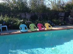 For a couple hundred dollars and a few weekends of your time, turn your ordinary outdoor pool into an outdoor oasis! We already had an area from our last pool… Backyard Chairs, Pool Chairs, Backyard Seating, Lawn Chairs, Backyard Ideas, Side Chairs, Modern Backyard, Dining Chairs, White Plastic Chairs