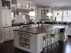 Beautiful painted inset custom cabinetry, inspired by a film. (Cultivate.com)