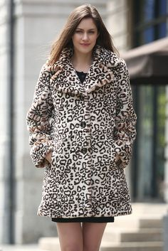 - 100% Acrylic, lush faux leopard print fur - Dry clean preferred; hand washable - Timeless elegance with its exotic leopard print and full length sleeves. A definitive fashion investment to have your
