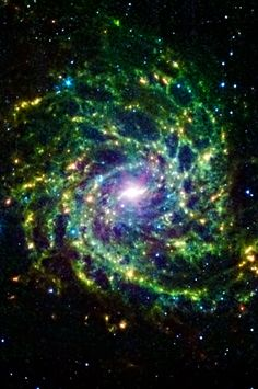 Galaxy IC 342 presents its delicate pattern of dust in this image from NASAs Spitzer. Seen in IR light, the faint starlight gives way to the glowing bright patterns of dust found throughout the galaxy's disk