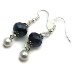 Complete your outfit with these subtle navy and silver drop earrings. Handmade, the earrings dangle from 0.925 sterling silver French hooks. A silvertone faux-pearl bead anchors the earrings, with a n