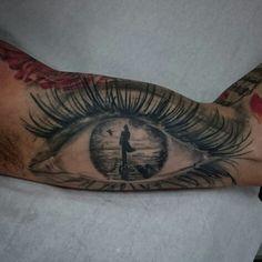 Healed eye tattoo