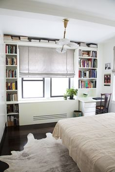 love the clever book shelves! Really saves space for someone like me who physically can't give away books. Too emotional.