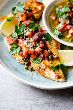 Juicy chicken breasts with a punchy olive, tomato and caper dressing is a great, fast summer meal. Not only is it gluten free and low carb, it's also absolutely delicious and is great for meal prepping ahead. #chicken #easydinner #glutenfree #lowcarb #sum