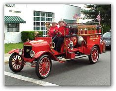 old FIRE TRUCKS | Tally Ho's antique pumper is a 1921 Ford. The Ford truck was restored ...
