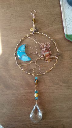 Wire wrapped beaded sun catcher with moon and owl agate moon.