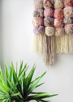 Learn how use a pom pom maker and make your own DIY gorgeous pom pom wall hanging. It& so much easier and faster than weaving! Pom Pom Crafts, Yarn Crafts, Diy And Crafts, Pom Pom Diy, Diy Pompon, Diy Y Manualidades, Yarn Wall Hanging, Wall Hangings, Pom Pom Maker
