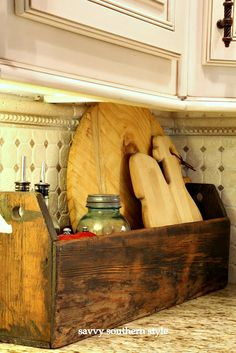 I think I'm gonna look for a vintage tool caddy to corral some of the stuff on my kitchen counter.  Savvy Southern Style: Eight Ways to Style a Vintage Tool Caddy