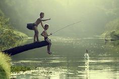 Asian boy fishing in a river. - Asian boy fishing in a river.