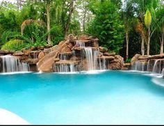 Swimming Pool Slide Ideas swiming pool design slides above ground Love This Pool With A Slidewaterfall Combo Looks Like A Resort