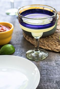 Try a Topolo Margarita in these handmade margarita glasses and pick up a copy of Rick Bayless' Frontera Margaritas and Guacamoles book.