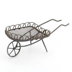 This whimsical mini wheelbarrow is perfect for lighthearted fairy garden designs. Shop our selection of miniature garden designs to complete your vision. Fairy Garden Accessories, Dollhouse Accessories, Wheelbarrow Garden, Garden Cart, Flower Cart, Mini Fairy Garden, Miniature Fairy Gardens, Miniature Dollhouse, Outdoor Chairs