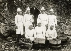 Female pearl divers next to Kokichi Mikimoto, inventor of cultivating pearls. Japan, 1921.