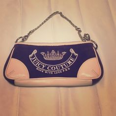NEVER USED! Juicy Couture Bag Smaller Juicy bag with chain handle and zip top. Leather and velour material. Cute J logo with heart on the back and heart keychain zipper! Juicy Couture Bags