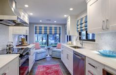 The Sitting Room Studio. Bright colors in galley kitchen.