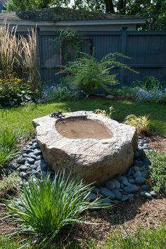 stone converted to bird bath
