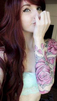 Beautiful tattoos. I also love her hair color.